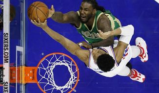 Boston Celtics' Jae Crowder, top, cannot get a shot past Philadelphia 76ers' Richaun Holmes during the first half of an NBA basketball game, Sunday, March 19, 2017, in Philadelphia. (AP Photo/Matt Slocum)