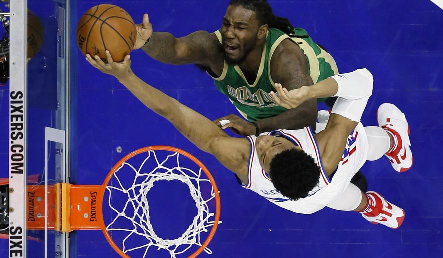 Boston Celtics' Jae Crowder, top, cannot get a shot past Philadelphia 76ers' Richaun Holmes during the first half of an NBA basketball game, Sunday, March 19, 2017, in Philadelphia. (AP Photo/Matt Slocum)
