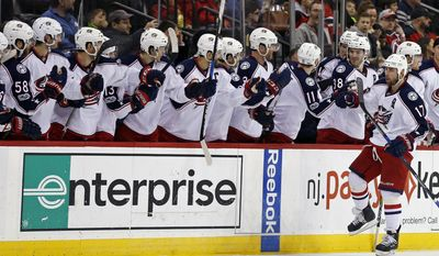 Columbus Blue Jackets center Brandon Dubinsky celebrates after scoring a goal on a penalty shot against the New Jersey Devils during the second period of an NHL hockey game, Sunday, March 19, 2017, in Newark, N.J. (AP Photo/Adam Hunger)
