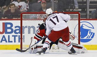 Columbus Blue Jackets center Brandon Dubinsky (17) scores on a penalty shot past New Jersey Devils goalie Cory Schneider (35) during the second period of an NHL hockey game, Sunday, March 19, 2017, in Newark, N.J. (AP Photo/Adam Hunger)