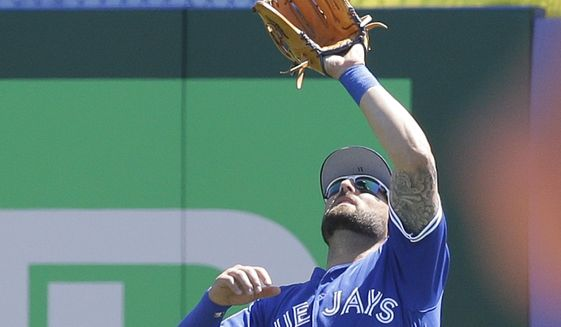 Toronto Blue Jays center fielder Kevin Pillar makes a catch in the fourth inning of a spring training baseball game against the Tampa Bay Rays, Saturday, March 18, 2017, in Dunedin, Fla. (AP Photo/John Raoux)