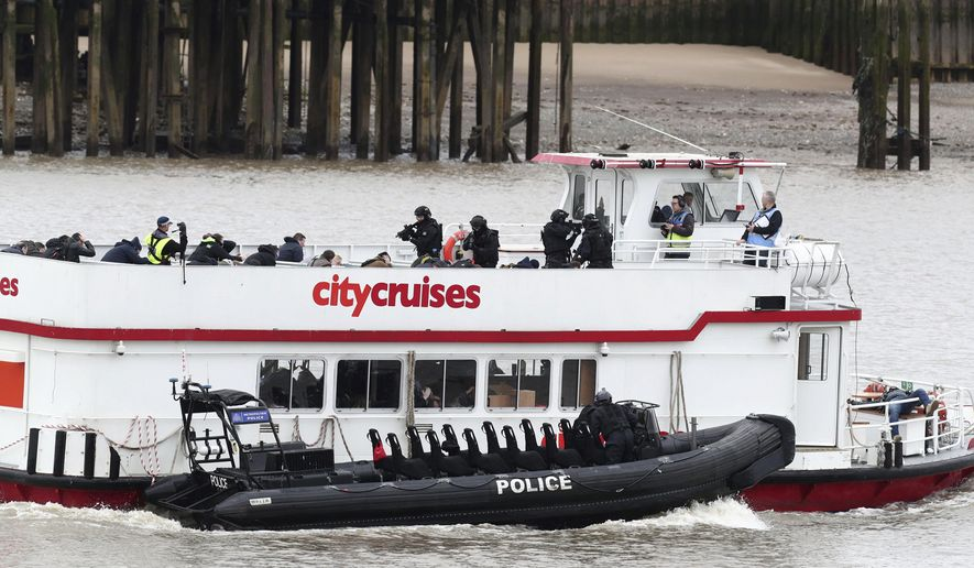 Police officers take part in a multi-agency exercise, to test the emergency services' response to a marauding terrorist attack in London, on the river Thames in east London, Sunday March 19, 2017. (Gareth Fuller/PA via AP)