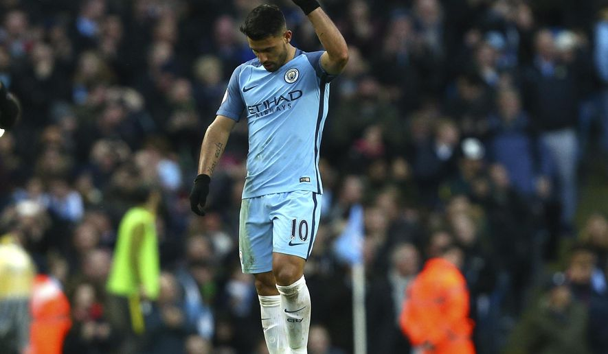 Manchester City's Sergio Aguero celebrates after scoring his side's first goal during the English Premier League soccer match between Manchester City and Liverpool at the Etihad Stadium in Manchester, England, Sunday March 19, 2017. (AP Photo/Dave Thompson)