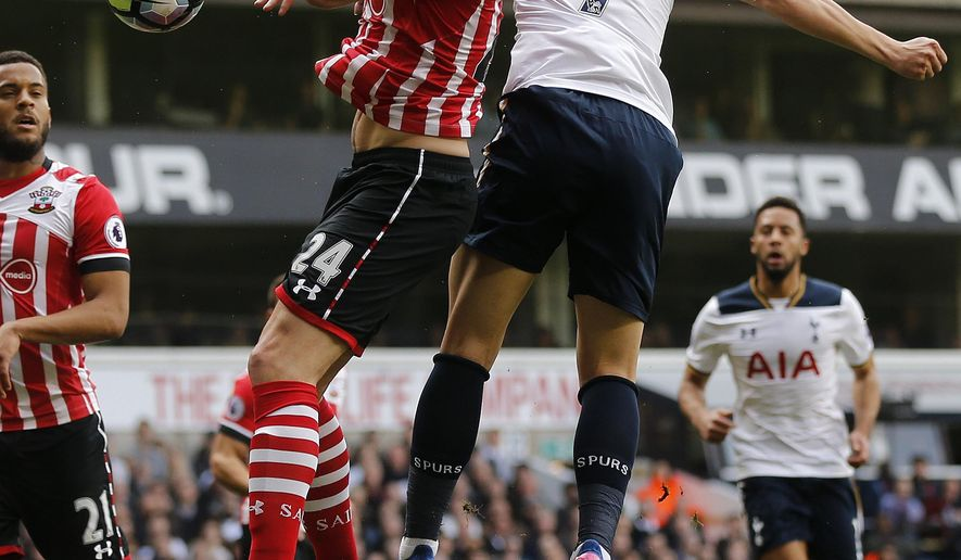 Southampton's Jack Stephens, left, and Tottenham Hotspur's Son Heung-min challenge for the ball during the English Premier League soccer match between Tottenham Hotspur and Southampton at White Hart Lane stadium in London, Sunday, March 19, 2017.(AP Photo/Frank Augstein)