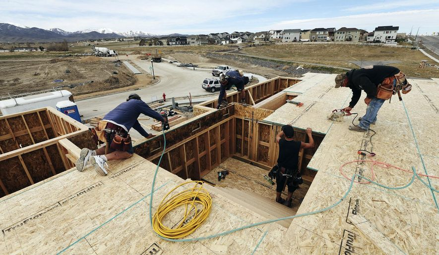For the first time in 40 years, the increase in households in Utah exceeds the number of new housing units, according to a recent study by James Wood of the University of Utah and a director for the Salt Lake Home Builders Association. Framers from Dave Miller Construction work on houses in Salt Lake City on Thursday, March 16, 2017. (Scott G Winterton/The Deseret News via AP)