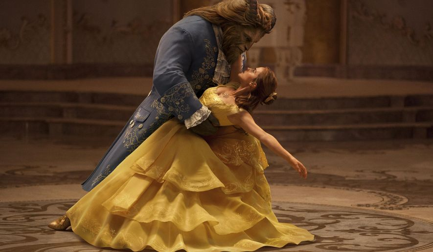 "This image released by Disney shows Dan Stevens as The Beast, left, and Emma Watson as Belle in a live-action adaptation of the animated classic ""Beauty and the Beast."" (Disney via AP)"
