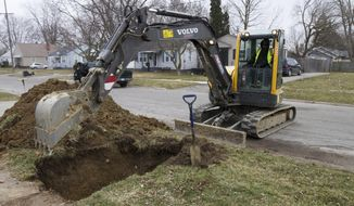 In a photo from March 10, 2017, work continues on the water replacement lines in Flint, Mich. Flint residents could still be a few years away from drinking unfiltered tap water as the city makes incremental progress on an ambitious timeframe to replace old water service lines that leached lead into homes and businesses. The project's coordinator said he has a goal of finishing the pipe replacements for residents in 2019 by fixing 6,000 service lines a year. (AP Photo/Chris Ehrmann)
