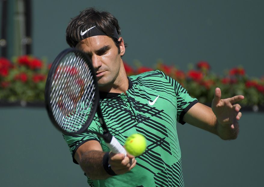 Roger Federer, of Switzerland, hits to Stan Wawrinka, of Switzerland, during the men's final at the BNP Paribas Open tennis tournament, Sunday, March 19, 2017, in Indian Wells, Calif. (AP Photo/Mark J. Terrill)