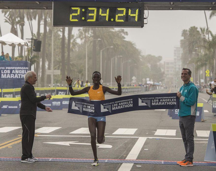 Hellen Jepkurgat, of Kenya, crosses the finish line as she wins the women's Los Angeles Marathon, Sunday, March 19, 2017, in Santa Monica, Calif. (Thomas R. Cordova/Los Angeles Daily News via AP)