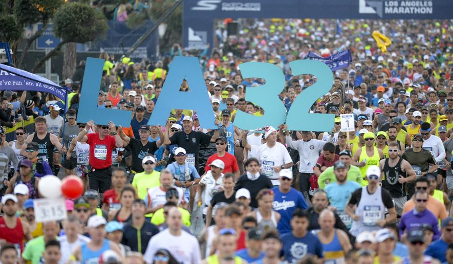 The 32nd Los Angeles marathon gets underway at the Dodger Stadium Sunday, March 19, 2017. The 26.2 mile race winds through Los Angeles and ends near the ocean in Santa Monica. (David Crane/Los Angeles Daily News via AP)