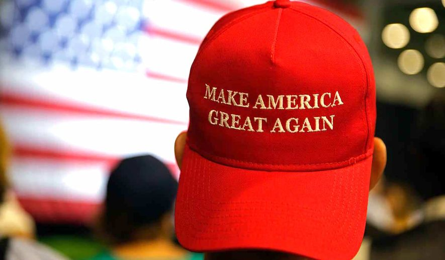 """A red """"Make America Great Again"""" ballcap supporting President Trump (Michael Conroy/AP Photo)"""