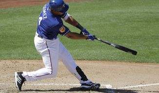 Texas Rangers' Carlos Gomez hits a two-run home run during the third inning of a spring training baseball game against the Seattle Mariners, Sunday, March 19, 2017, in Surprise, Ariz. (AP Photo/Darron Cummings)