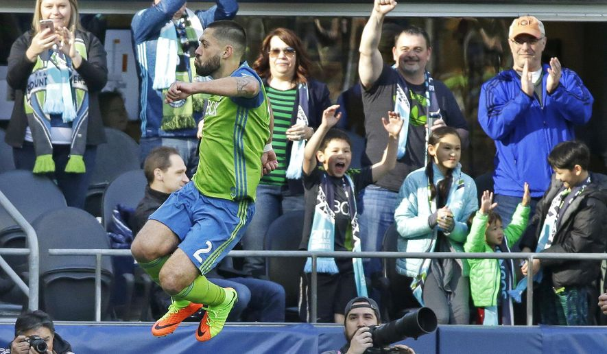 Seattle Sounders forward Clint Dempsey leaps and celebrates in front of fans after he scored a goal against the New York Red Bulls during the first half of an MLS soccer match, Sunday, March 19, 2017, in Seattle. (AP Photo/Ted S. Warren)