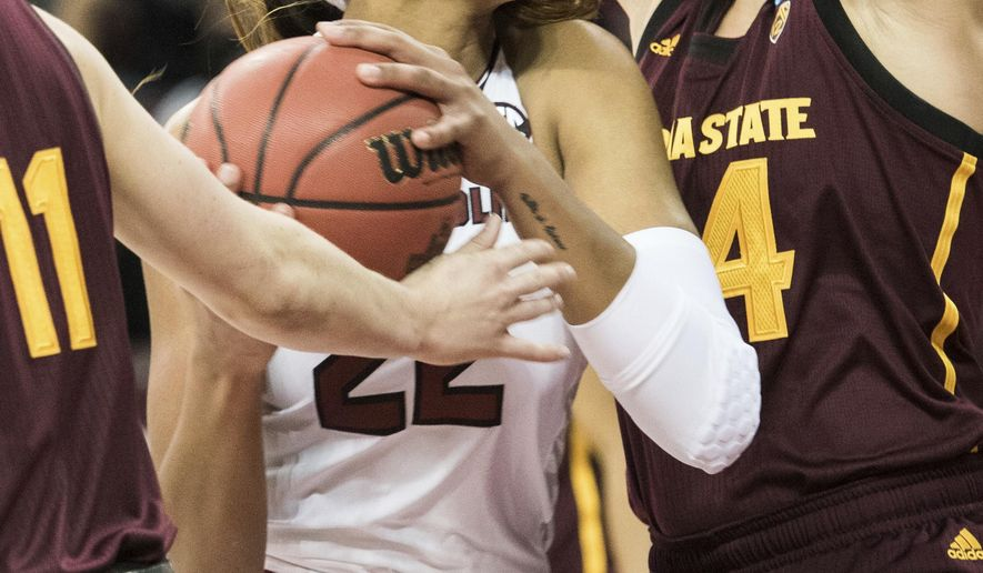 South Carolina forward A'ja Wilson (22) drives to the basket against Arizona State forward Kelsey Moos, right, during a second-round game in the NCAA women's college basketball tournament Sunday, March 19, 2017, in Columbia, S.C. (AP Photo/Sean Rayford)