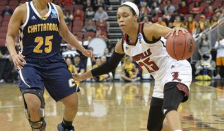 Louisville's Asia Durr (25) attempts to drive around the defense of Chattanooga's Chelsey Shumpert (25) in the second half of a first-round game in the women's NCAA college basketball tournament, Saturday, March 18, 2017, in Louisville, Ky. Louisville won 82-62. (AP Photo/Timothy D. Easley)