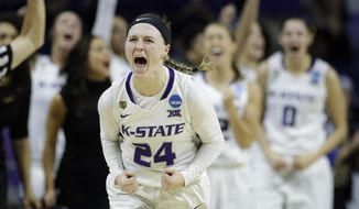 Kansas State's Kindred Wesemann (24) celebrates after making a three-point shot during the second half of a first-round game against Drake in the NCAA women's college basketball tournament Saturday, March 18, 2017, in Manhattan, Kan. Kansas State won 67-54. (AP Photo/Charlie Riedel)