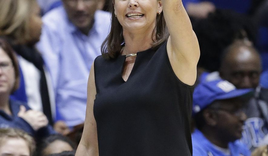 Duke head coach Joanne P. McCallie directs her team during the second half of a first-round game in the NCAA women's college basketball tournament against Hampton in Durham, N.C., Saturday, March 18, 2017. Duke won 94-31. (AP Photo/Gerry Broome)