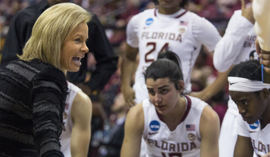 Florida State head coach Sue Semrau, left, talks to her team in the huddle during the first half of a second-round game against Missouri in the NCAA women's college basketball tournament in Tallahassee, Fla., Sunday, March 19, 2017. (AP Photo/Mark Wallheiser)
