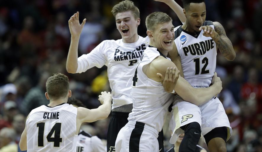 Purdue players celebrates after defeating Iowa State 80-76 in an NCAA college basketball tournament second-round game Saturday, March 18, 2017, in Milwaukee. (AP Photo/Kiichiro Sato)