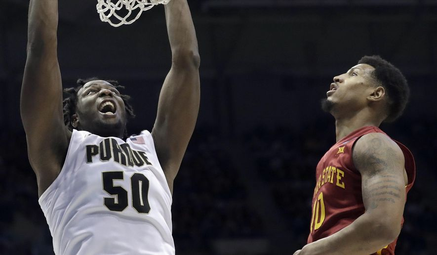 Purdue's Caleb Swanigan (50) dunks against Iowa State's Darrell Bowie (10) during the second half of an NCAA college basketball tournament second-round game Saturday, March 18, 2017, in Milwaukee. (AP Photo/Morry Gash)