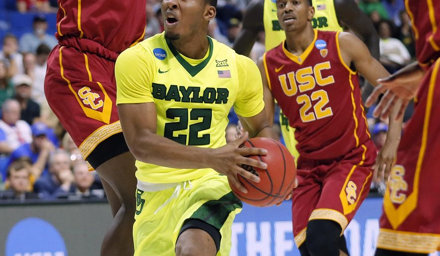 Baylor guard King McClure (22) works through Souther California defenders Chimezie Metu (4), De'Anthony Melton (22) and Shaqquan Aaron, right, on a drive to the basket for a shot in the first half of a second-round game in the men's NCAA college basketball tournament in Tulsa, Okla., Sunday, March 19, 2017. (AP Photo/Tony Gutierrez)