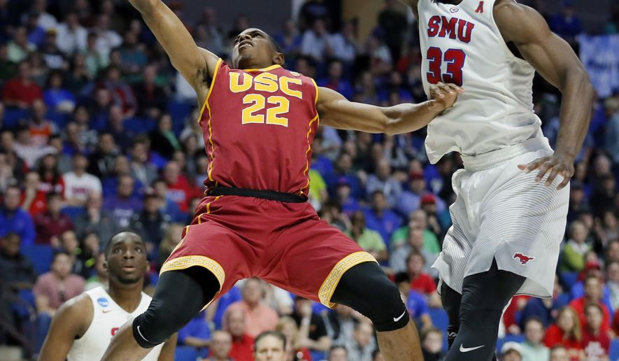 Southern California's De'Anthony Melton (22) goes up for a shot as SMU's Semi Ojeleye (33) defends in the second half of a first-round game in the men's NCAA college basketball tournament in Tulsa, Okla., Friday March 17, 2017. (AP Photo/Tony Gutierrez)