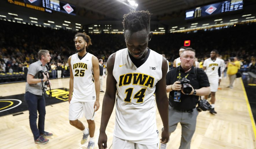Iowa guard Peter Jok (14) walks off the court at the end of a second-round game against TCU in the NIT college basketball tournament, Sunday, March 19, 2017, in Iowa City, Iowa. TCU won 94-92. (AP Photo/Charlie Neibergall)