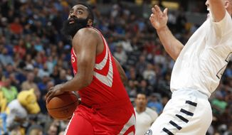 Houston Rockets guard James Harden, left, drives to the basket as Denver Nuggets center Mason Plumlee defends in the first half of an NBA basketball game Saturday, March 18, 2017, in Denver. (AP Photo/David Zalubowski)