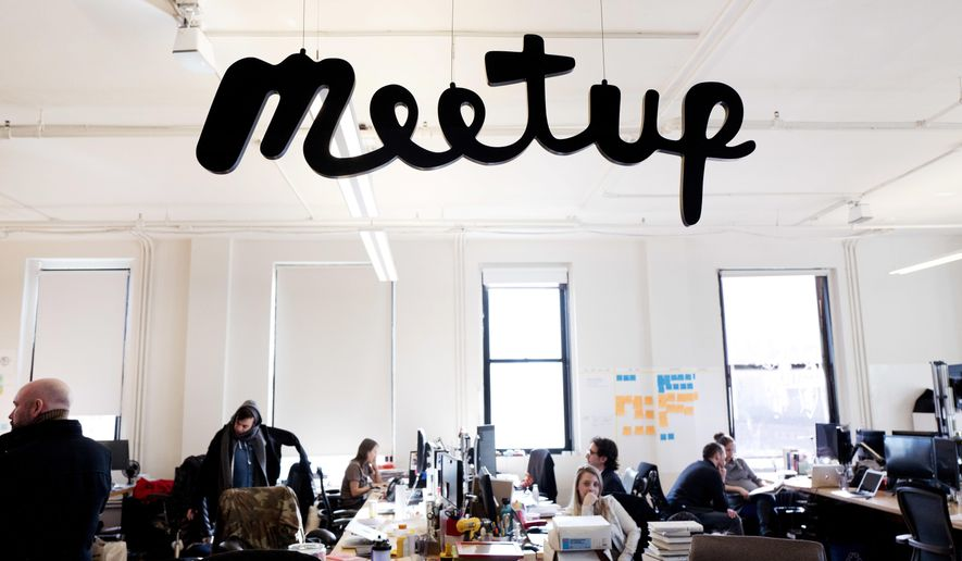In this March 13, 2017 photo, staff members of Meetup are at work in the company's New York office. Meetup.com is taking a leap into the Trump resistance. It's a risky move for the company, whose millions of U.S. members include many Trump supporters. But the decision reflects an increasing willingness of some major tech firms to take on the Republican president. (AP Photo/Mark Lennihan)
