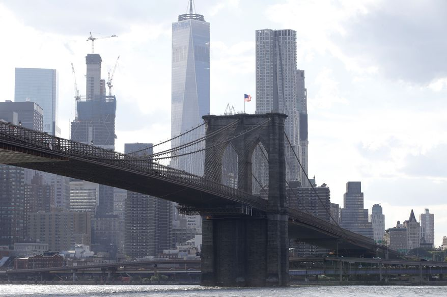 The Brooklyn Bridge spans the East River from Brooklyn into Manhattan, as seen from Brooklyn Bridge Park, Thursday, June 30, 2016, in New York.  (AP Photo/Kathy Willens)
