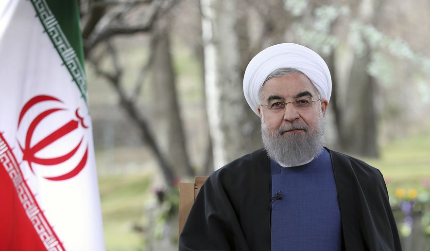 In this photo released by official website of the Iranian Presidency on Monday, March 20, 2017, President Hassan Rouhani poses for a portrait in a session to deliver a message for the Iranian New Year, Iran. Nowruz, a festival to celebrate the new Persian year starts with the spring. Iranians follow the Persian solar year, and this year, they begin the year 1396. (Iranian Presidency Office via AP)