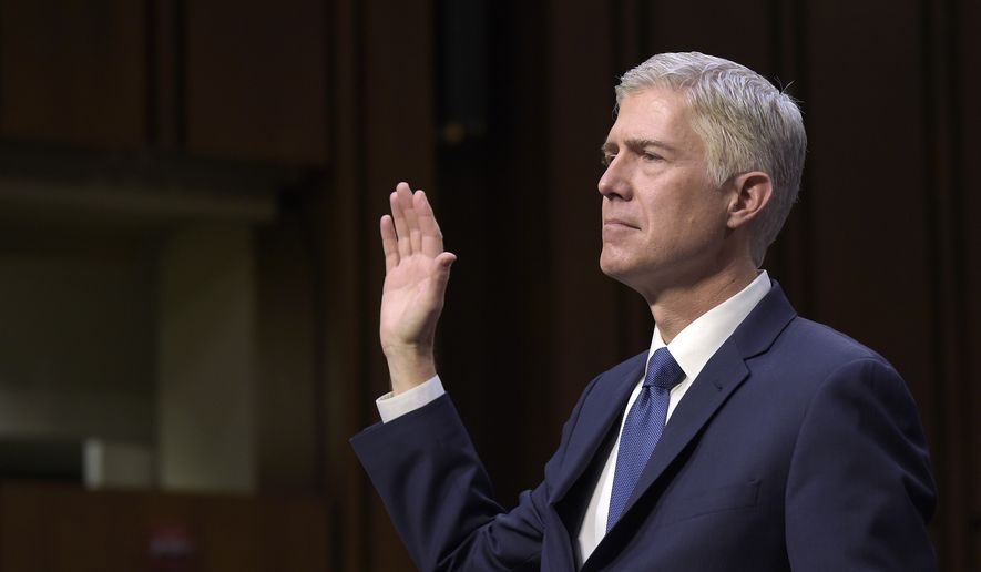 Supreme Court Justice nominee Neil Gorsuch is sworn in on Capitol Hill in Washington, Monday, March 20, 2017, during his confirmation hearing before the Senate Judiciary Committee. (AP Photo/Susan Walsh)