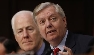 Senate Judiciary Committee member Sen. Lindsey Graham, R-S.C., right, accompanied by Sen. John Cornyn, R-Texas, speaks on Capitol Hill in Washington, Monday, March 20, 2017, during the committee's confirmation hearing for Supreme Court Justice nominee Neil Gorsuch. (AP Photo/Pablo Martinez Monsivais) **FILE**