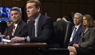 Supreme Court Justice nominee Neil Gorsuch and his wife Marie Louise, listen as Sen. Michael Bennet, D-Colo., second from left, accompanied by Sen. Cory Gardner, R-Colo., introduces Gorsuch during opening statements on Capitol Hill in Washington, Monday, March 20, 2017, at Gorsuch's confirmation hearing before the Senate Judiciary Committee.  (AP Photo/Susan Walsh)