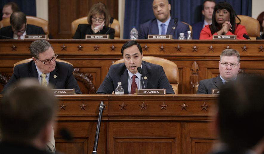 House Intelligence Committee member Rep. Joaquin Castro, D-Texas, center, flanked by Rep. Denny Heck, D-Wash., left, and Rep. Rick Crawford, R-Ark., questions FBI Director James Comey on Capitol Hill in Washington, Monday, March 20, 2017, during the committee's hearing on allegations of Russian interference in the 2016 U.S. presidential election. (AP Photo/J. Scott Applewhite) ** FILE **