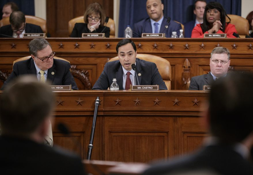 House Intelligence Committee member Rep. Joaquin Castro, D-Texas, center, flanked by Rep. Denny Heck, D-Wash., left, and Rep. Rick Crawford, R-Ark., questions FBI Director James Comey on Capitol Hill in Washington, Monday, March 20, 2017, during the committee's hearing on allegations of Russian interference in the 2016 U.S. presidential election. (AP Photo/J. Scott Applewhite)