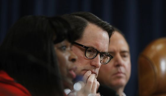 House Intelligence Committee member Rep. Jim Himes, D-Conn., center, and the committee's ranking member, Rep. Adam Schiff, D-Calif., right, listen as committee member Rep. Terri A. Sewell, D-Ala., left, questions FBI Director James B. Comey and National Security Agency Director Michael Rogers on Capitol Hill in Washington, Monday, March 20, 2017, during the committee's hearing regarding allegations of Russian interference in the 2016 U.S. presidential election. AP Photo/Manuel Balce Ceneta) ** FILE **
