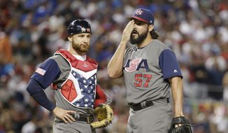 FILE - In this March 11, 2017, file photo, U.S. relief pitcher Tanner Roark stands on the mound with catcher Jonathan Lucroy during the sixth inning in a first-round game of the World Baseball Classic against the Dominican Republic in Miami. Roark is getting a chance to redeem himself in the World Baseball Classic. The Washington Nationals pitcher will start for the United States against Japan in the semifinals at Dodger Stadium on Tuesday night, March 21. (AP Photo/Lynne Sladky, File) **FILE**