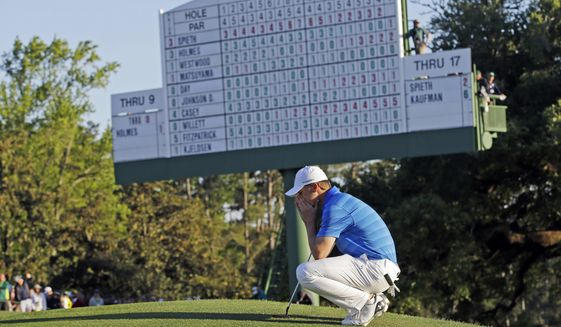 FILE - In this April 10, 2016, file photo, Jordan Spieth waits to putt at the 18th green during the final round of the Masters golf tournament in Augusta, Ga. Two weeks before the Masters begins, Spieth is looking forward to it being over. Spieth was on the verge of becoming only the fourth player to win back-to-back at Augusta National when he took a five-shot lead to the back nine. He dropped six shots over the next three holes, including two balls in Rae's Creek on the 12th hole for a quadruple bogey, and wound up three shots behind Danny Willet. (AP Photo/David J. Phillip, File)