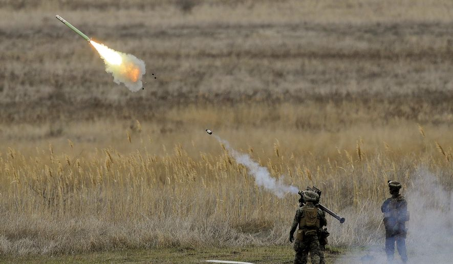 US Marines launch a Stinger missile at the Capu Midia Surface to Air Firing Range, on the Black Sea coast in Romania, Monday, March 20, 2017. About 1,200 US and Romanian troops take part in the Spring Storm 17 exercise, meant to simulate defense of the Romanian Black Sea coastline and urban areas. (AP Photo/Vadim Ghirda)