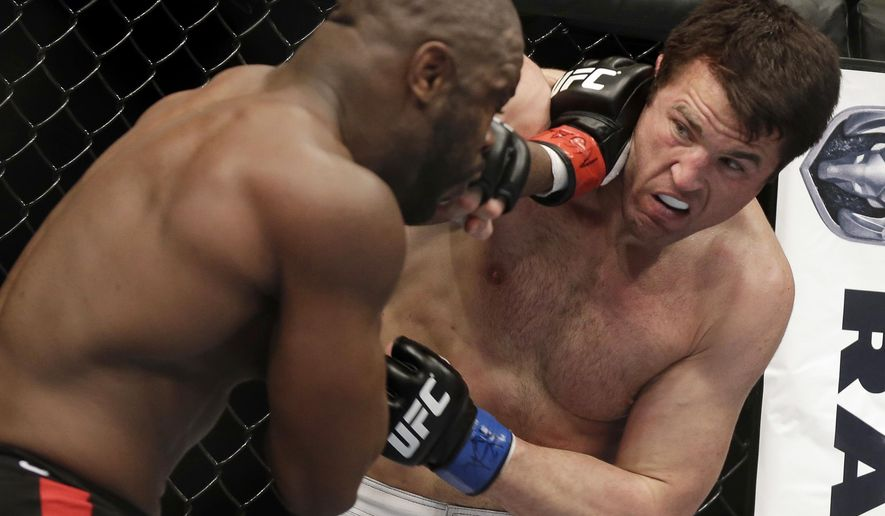 FILE - In this Nov. 16, 2013, file photo, Rashad Evans, left, and Chael Sonnen trade punches during a mixed martial arts bout in Las Vegas. Sonnen will fight Wanderlei Silva on June 24, 2017, at Madison Square Garden when the Bellator mixed martial arts promotion makes its New York debut. The bout will headline just the second pay-per-view show in Bellator history. (AP Photo/Isaac Brekken, File)