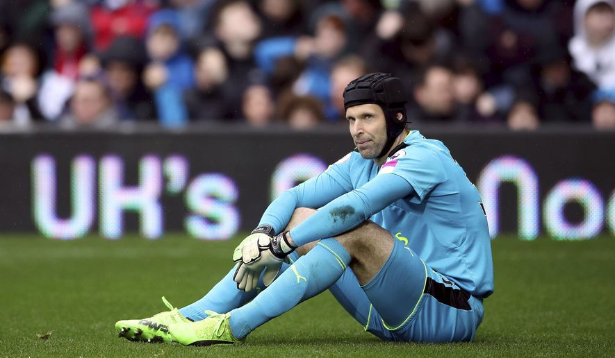 Arsenal goalkeeper Petr Cech sits with an injury, during the English Premier League soccer match between West Bromwich Albion and Arsenal,  at The Hawthorns, in West Bromwich, England, Saturday March 18, 2017.  (Nick Potts/PA via AP)