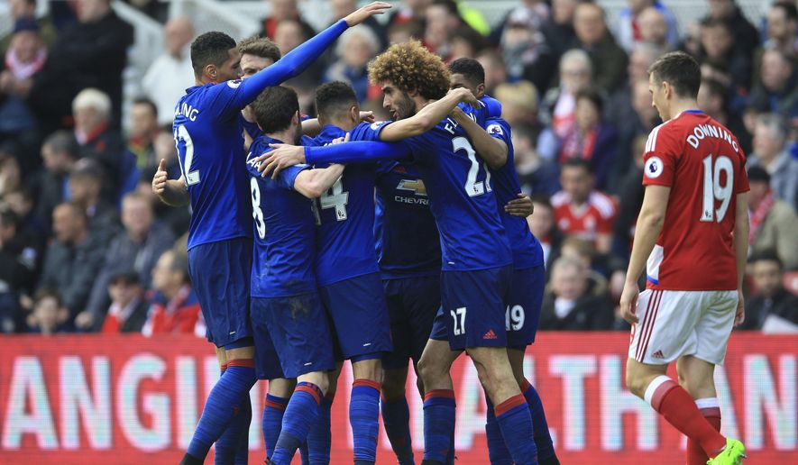 Manchester United's Marouane Fellaini, center right, celebrates with teammates after scoring his side's first goal of the game during their English Premier League soccer match against Middlesbrough at the Riverside Stadium, Middlesbrough, England, Sunday, March 19, 2017. (Nigel French/PA via AP)