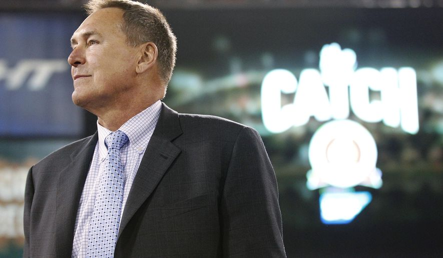 """FILE - In this Dec. 23, 2013, file photo, former San Francisco 49ers wide receiver Dwight Clark is honored at halftime of an NFL football game between the 49ers and the Atlanta Falcons in San Francisco. Clark stands near the spot where he made a catch so famous it is referred to as """"The Catch.""""  Clark says he has Lou Gehrig's disease and suspects playing football might have caused the illness. Clark announced Sunday, March 19, 2017. on Twitter that he has amyotrophic lateral sclerosis, a disease that attacks cells that control muscles. Clark linked to a post on his personal blog detailing his ALS diagnosis, but the site crashed Sunday night, apparently from an overflow of traffic. (AP Photo/Tony Avelar, File)"""