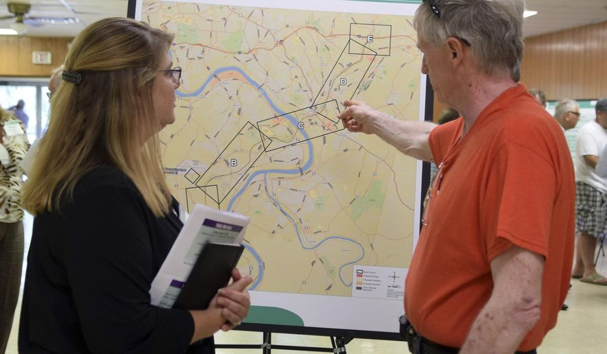 In this photo taken Aug. 9, 2016, Diane Nulton, left, of McCormick Taylor, talks with resident Harry Thompson about where the new Mon-Fayette Expressway will go during a public meeting in Pittsburgh. The future of the $1.6 billion expressway faces a crucial vote Monday, March 20, 2017, and two top local leaders say they are not convinced the project should move ahead. (Gracey Evans/Pittsburgh Post-Gazette via AP)