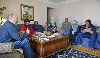 In this Feb. 9, 2017 photo, from left, Scott Martin, Barbara Neafcy, Ayn C. Downey,  Debbie Martin, Fern Chappell, Sumera Makhdoom and Ayn L. Downey gather as members of the Race Unity Group of Carbondale, Ill. The group has met weekly since February 2016 to discuss issues and find ways to create better interracial cooperation in the community. (Byron Hetzler/The Southern, via AP)