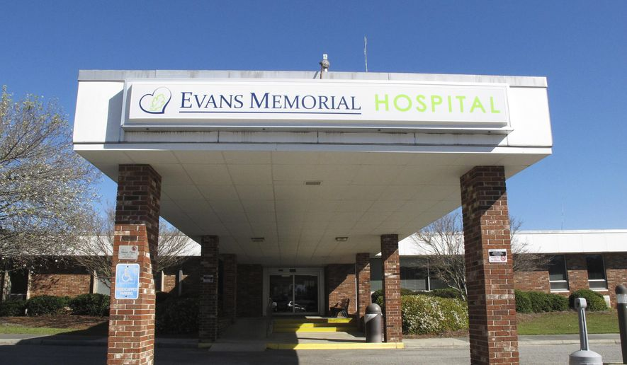 This Thursday, March 9, 2017, photo shows the main entrance to Evans Memorial Hospital in Claxton, Ga. Like many other rural hospitals in the U.S., Evans Memorial has struggled to keep its doors open while treating patients who tend to be older, poorer and often uninsured. (AP Photo/Russ Bynum)