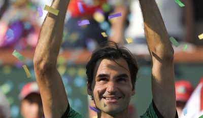 Roger Federer, of Switzerland, celebrates his 6-4, 7-5 win over Stan Wawrinka, of Switzerland, in the men's final of the BNP Paribas Open tennis tournament, Sunday, March 19, 2017, in Indian Wells, Calif. (AP Photo/Mark J. Terrill)