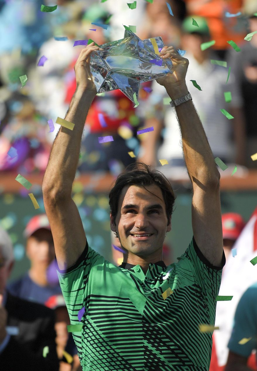 Roger Federer, of Switzerland, celebrates his 6-4, 7-5 win over Stan Wawrinka, of Switzerland, in the men's final of the BNP Paribas Open tennis tournament, Sunday, March 19, 2017, in Indian Wells, Calif. (AP Photo/Mark J. Terrill)