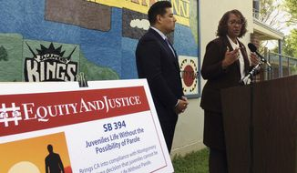 California state Democratic Senators Ricardo Lara of Bell Gardens, left, and Holly Mitchell of Los Angeles, discuss their proposed juvenile justice legislation Monday, March 20, 2017, at Leataata Floyd Elementary School in Sacramento, Calif. California should start treating juvenile offenders more like children, state lawmakers said Monday as they promoted bills that they said reflect research showing that children's brains are different from adults. (AP Photo/Don Thompson)